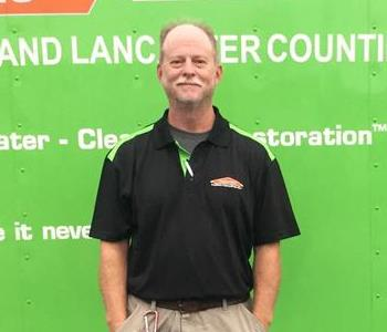 Rodney Barringer our Production Manager in front of a SERVPRO Van