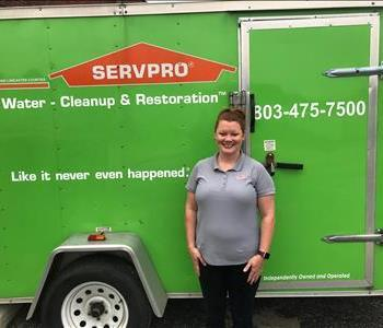 Kerri Rice is in front of a SERVPRO equipment trailer