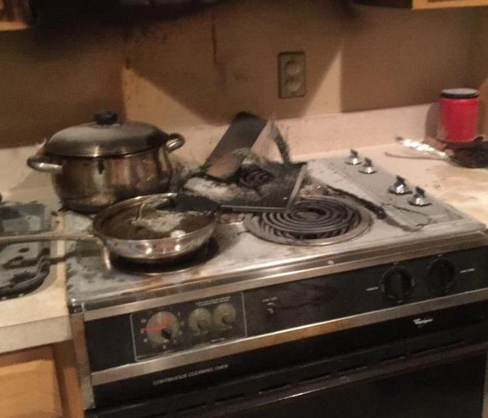 stove that has been burned from food left unattended