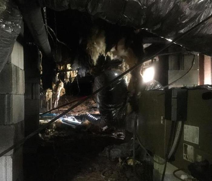 Crawlspace with heavy fire damage from a lightning stike