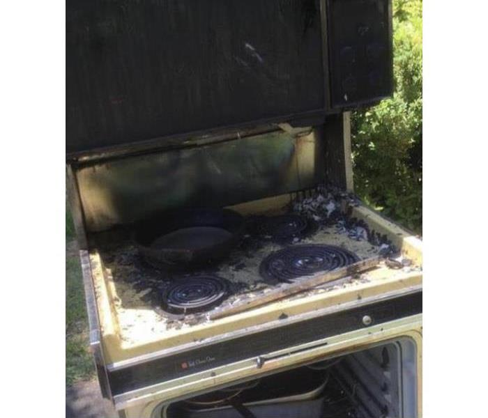 burned stove in the front yard