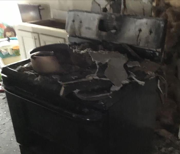 Unattended stove is now totally burned as well as the counters and ceiling